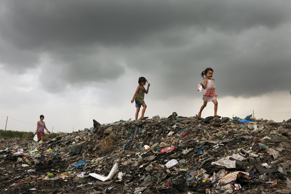 Hidden cities is a joint WHO / UN-HABITAT report about urbanization and global health issues. Photo stories from around the world reflect the hidden realities urban dwellers are facing, and highlight some health inequities.  Kids play on the garbage dump close to their home. Slum area in Tondo, Manila, Philippines