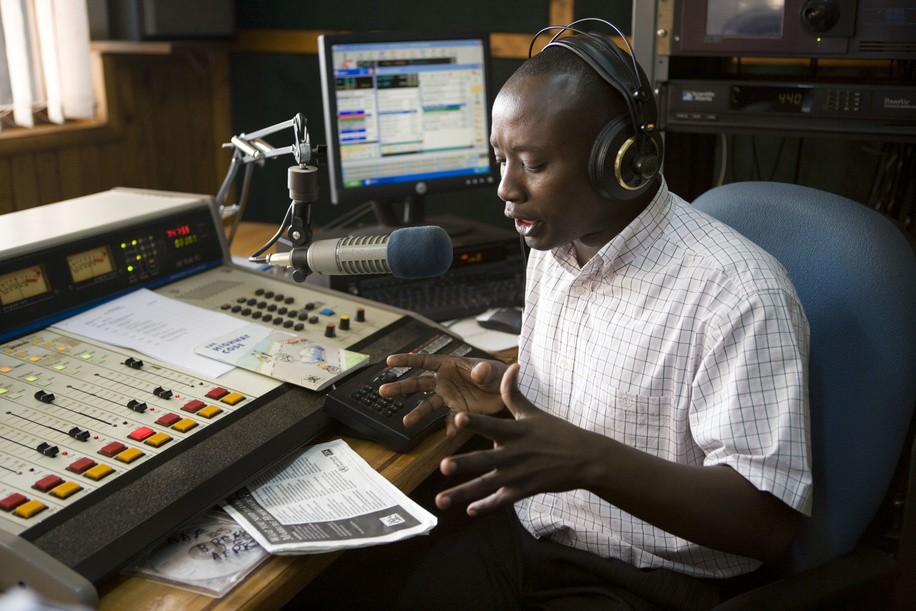 At Radio West in Mbarara, a city in the Western Region of Uganda, a DJ provides information on Marburg hemorrhagic fever. The Ugandan Ministry of Health, Centers for Disease Control and Prevention (CDC) and WHO work with local media to provide the public with key information on the disease. In addition to print, radio is an important vehicle to support information  and education campaigns.  Marburg virus disease (MVD), formerly known as Marburg haemorrhagic fever, is a severe, often deadly illness. The Marburg virus is a close relative of Ebola, and the two zoonotic pathogens are clinically similar and lead to severe viral haemorrhagic fever in humans. Though rare, both diseases have the capacity to cause dramatic outbreaks with high fatality rates. There is as yet no proven treatment or vaccine available for MVD. In 2007, two cases of Marburg haemorrhagic fever were identified in a remote mining area in western Uganda. One, a miner, died in July. A public information campaign was launched along with training courses for local health workers. Concurrently, an international team of experts and scientists worked to identify the hosts of the virus and its mode of natural transmission in the environment. In their quest to locate the reservoir of the Marburg virus, team members explored Kitaka mine cave, where the outbreak appeared to have started. At a laboratory set up nearby, they examined bats that were captured in the mine. Working through the night, scientists searched blood and organ samples for Marburg virus antibodies. This photo story documents the joint efforts of WHO and its partners in the Global Outbreak Alert and Response Network (GOARN) to monitor, investigate, and control the outbreak of Marburg fever in Uganda.