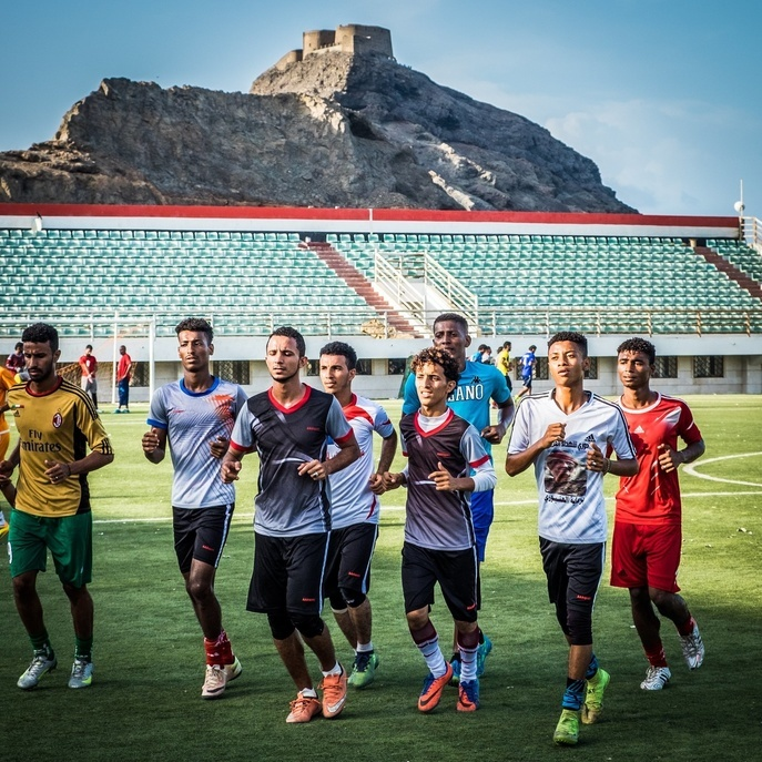 A group of young athletes during football practice at the Al-Tilal Sports Club stadium in Aden, Yemen.
