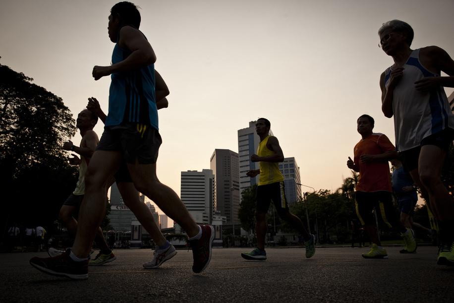 People exercising at Lumpini park in central Bangkok.