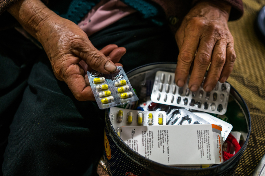 Hoa, 68, a diabetes sufferer, with her daily medications in her home in Doi Son, rural Ha Nam Province, Vietnam.