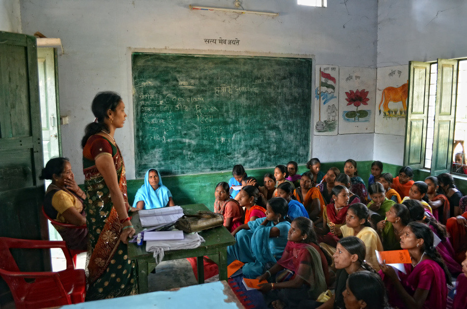 Teenage girls listening attentively and taking notes during a class on nutrition taught at a village school in Dohari, Uttar Pradesh, India.  Photos of children in and around schools in India