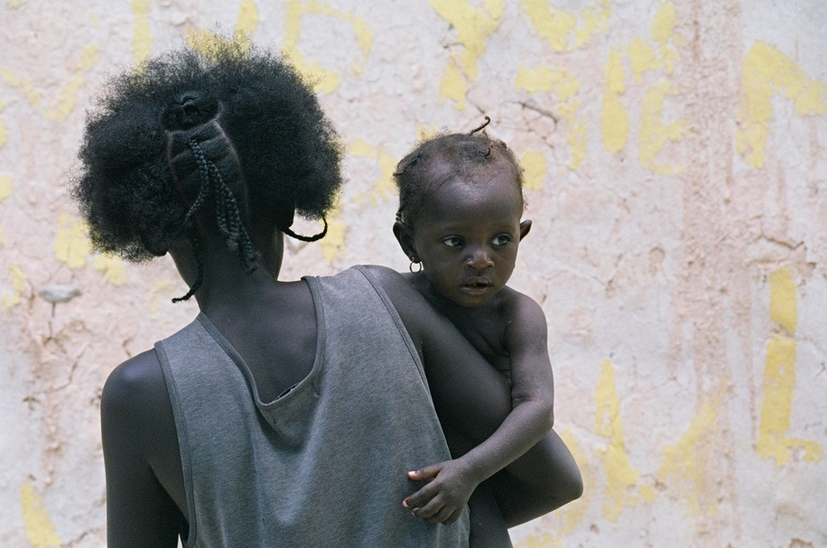 The Republic of Haiti is a Caribbean country. It occupies the western, smaller portion of the island of Hispaniola, in the Greater Antillean archipelago, which it shares with the Dominican Republic. Here is a set of pictures that were taken on the side of the report on the syphilis in Haiti by Andy Craggs in 2006.  A mother and her child in a village in rural Haiti.