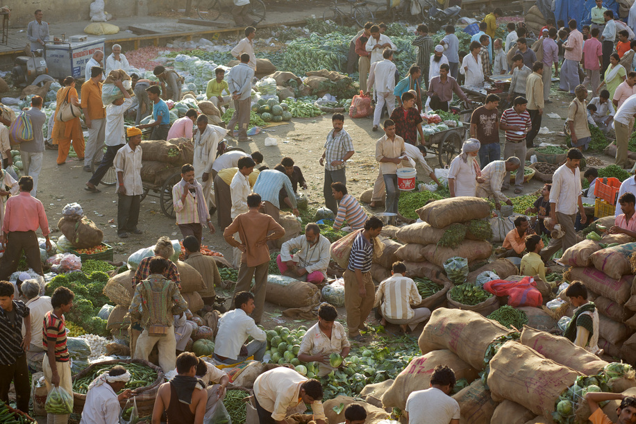 This series focuses on different aspects of having influenza in India.  A crowd of traders at a wholesale vegetable market in Delhi.