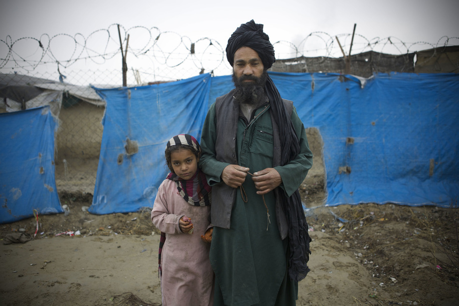 IDP camps in Afghanistan.  Mir-Adam, aged 58 and father of 9 children, whose family was displaced from Helmand to Kabul about seven years ago, lives at the Charah-e-Qambar refugee camp where he works as a guard at the mobile clinic facilitated by WHO.