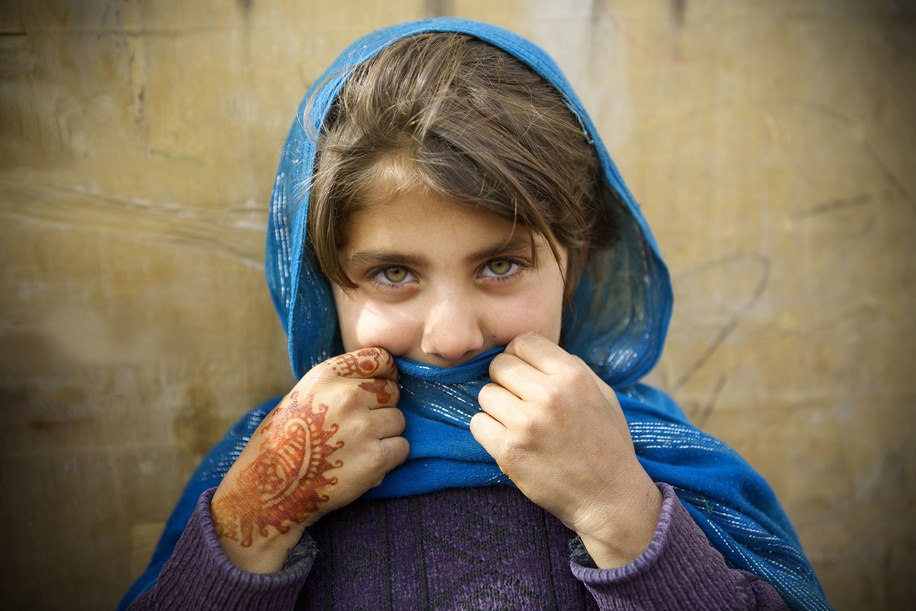 IDP camps in Afghanistan.  Mahjabin, aged 6, whose family was displaced from Helmand to Kabul about two years ago, lives at the Pul-e-Campany refugee camp in Kabul, Afghanistan.   Most families were forced to flee their homes in southern Afghanistan due to Taliban fighting and are forced to spend the harsh winter season at the camp in poverty.