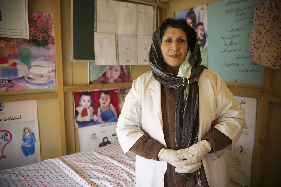 Mobile clinic in Afghanistan.   Dr Aziza, aged 45 and mother of six children works as a midwife and OPD (Out Patient Department) doctor at the mobile clinic inside the Nasaji-e-Bagrami refugee camp in Kabul, Afghanistan.  Dr Aziza has been working as a midwife for 30 years.