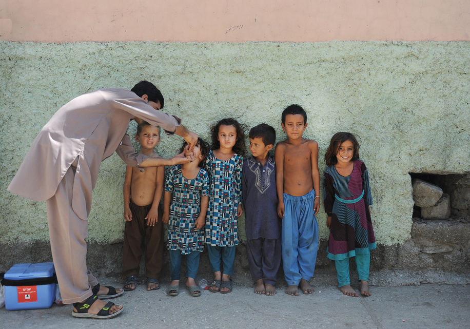 Polio vaccination campaign in Afghanistan.  Afghan vaccinator goes house by house in every street to vaccinate children under five years old in Asadabad.