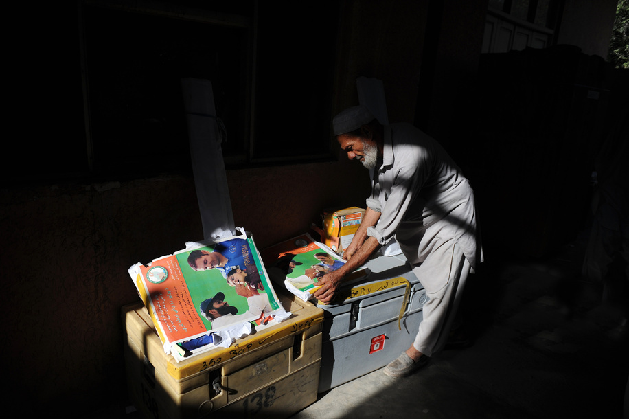 Polio vaccination campaign in Afghanistan.   Afghan coordinators collect vaccine supply a day before the start of national polio vaccination campaign from vaccine main department in Jalalabad.