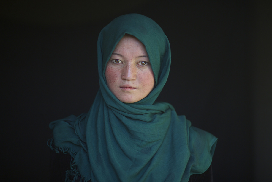 Polio Vaccination in Afghanistan   Sakina, 19, who works with the polio campaign as a Cluster Supervisor poses for a portrait  during the first day of a polio vaccination campaign in Bamyan.