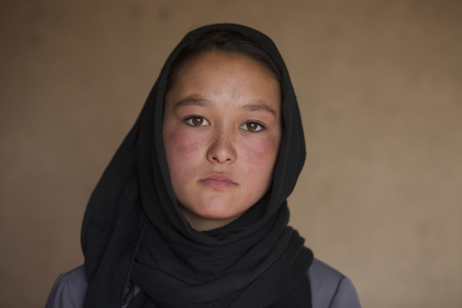Polio Vaccination in Afghanistan   Zainab, 17, who works with the polio campaign as a volunteer vaccinator poses for a portrait  during the last day of a vaccination campaign in Bamyan.