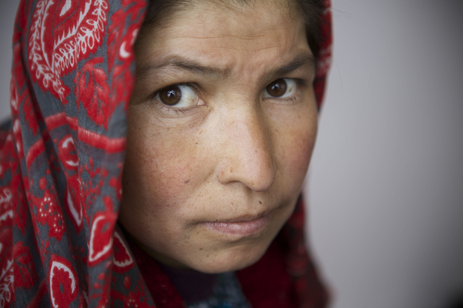 Sakina, aged 30 and mother of 4, holds her 22-day-old child at the mobile clinic facilitated by WHO at the Jandargal village located in Shiber district in Bamiyan, Afghanistan.