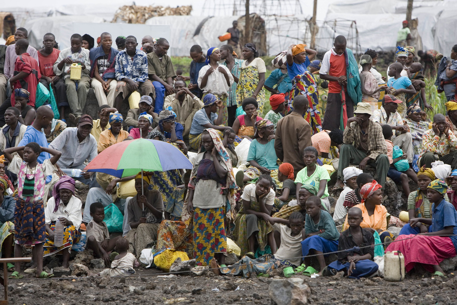 Feature about Internally Displaced People (IDP) due to conflicts in Democratic Republic of the Congo.  Men, women and children waiting to get food.