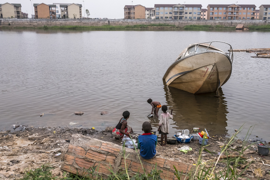 Shores of the Congo River in Kinshasa. On the background can be seen the gated community