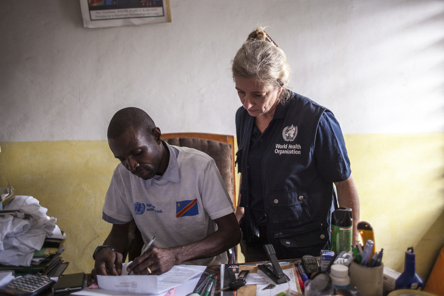 In response to the outbreak, a national coordination committee has been activated. Suspected cases of yellow fever continue to be investigated on a daily basis.  Dr Michel Makengo Nzaz (l), chief doctor of the Limete health zone, is pictured with a WHO agent at his office during a yellow fever vaccination campaign in Kinshasa, on August 19, 2016.  Title of WHO staff and officials reflects their respective position at the time the photo was taken.