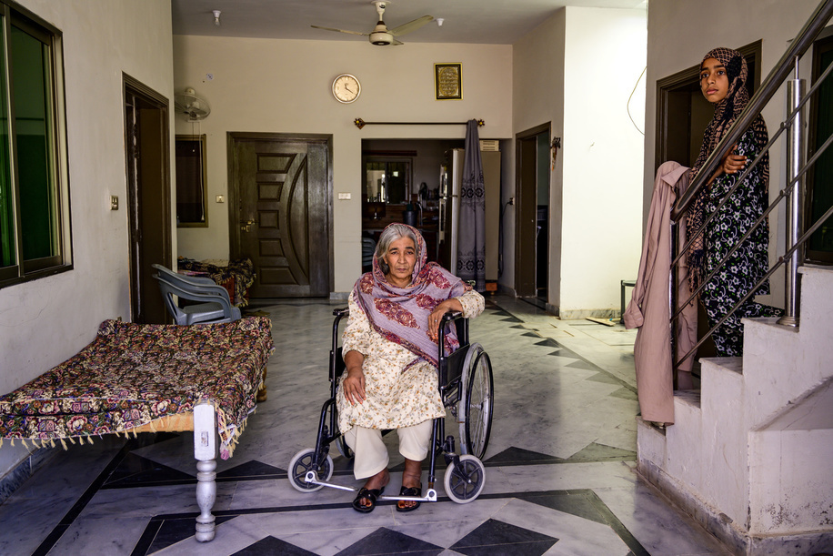 Islamabad, Pakistan - 5 May, 2019: Fozia, 64 and a health worker in her family house during a field assistive technology survey for person with disabilities in the outskirts of Islamabad.   Fozia is suffering from a paralysis since 2016, when she had a stroke while sleeping.
