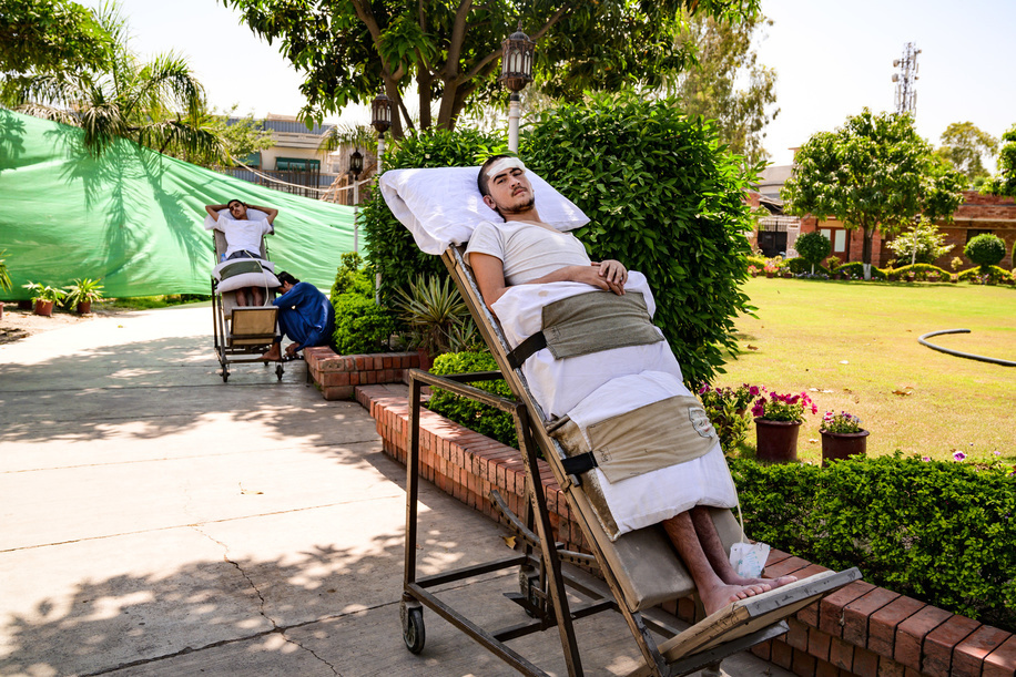 Patient recovering in the gardens of the Paraplegic Centre of Peshawar, Pakistan. A car hit him from the back when driving a bicycle and got a  spinal cord injury.