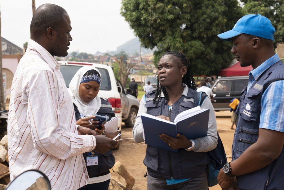 WHO's response to Ebola virus disease (EVD) outbreak in the Democratic Republic of Congo.  WHO Epidemiologist Gisele Mvumbi (centre) at work with WHO Contact Tracing teams. Here as she speaks to local village leader. - Title of WHO staff and officials reflects their respective position at the time the photo was taken.