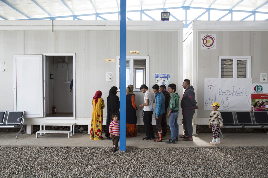 Medical Clinic in Debaga Two Refugee Camp - In March 2017 WHO began building a primary health clinic in Debaga 2 camp, south of Erbil in the Makhour District of northern Iraq. It receives 50-60 patients every day.  It employs 21 staff, including doctors, nurses, paramedics and laboratory technicians. They work on a rotating roster to provide healthcare 24 hours a day, seven days a week.  The clinic has seven caravans, which house examining rooms, a pharmacy, a small laboratory where blood and urine tests are conducted, a reproductive health centre, and a baby hut, where children's height and weight are monitored. The clinic also provides routine vaccination against preventable diseases as well as health awareness and health education. - Caption was not provided by the photographer. Therefore, a generic caption has been applied to this image.