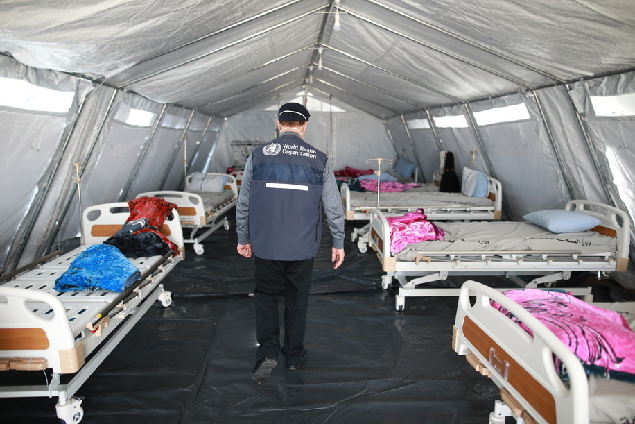 On 22 March 2020, WHO staff visit the new Rafah Crossing Field Hospital in the Gaza Strip. Set up by Ministry of Health with WHO support as part of the COVID-19 response, the field hospital contains a 38-bed treatment facility with 6 intensive care unit beds and 40 beds for moderate cases.  Interim Head of WHO Gaza sub-office Abdelnaser Soboh  Title of WHO staff and officials reflects their respective position at the time the photo was taken.