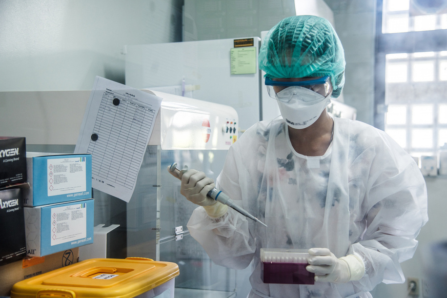 A technician testing for COVID-19 in the RT-PCR lab at the Department of Medical Sciences of the Ministry of Public Health.