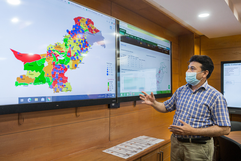COVID-19: PAKISTAN  Syed Razzaq, technical officer for MIS/IT information management shows data on Pakistan's COVID-19 response at the operations room in the National Emergency Operation Centre (NEOC) for Polio Eradication, located inside the National Institute of Health.