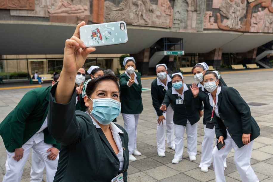 Nurses, along with the chief of nursing programs, Fabiana Zepeda Arias (back center), after an outdoor debriefing meeting at the Mexican Institute of Social Security (IMSS).