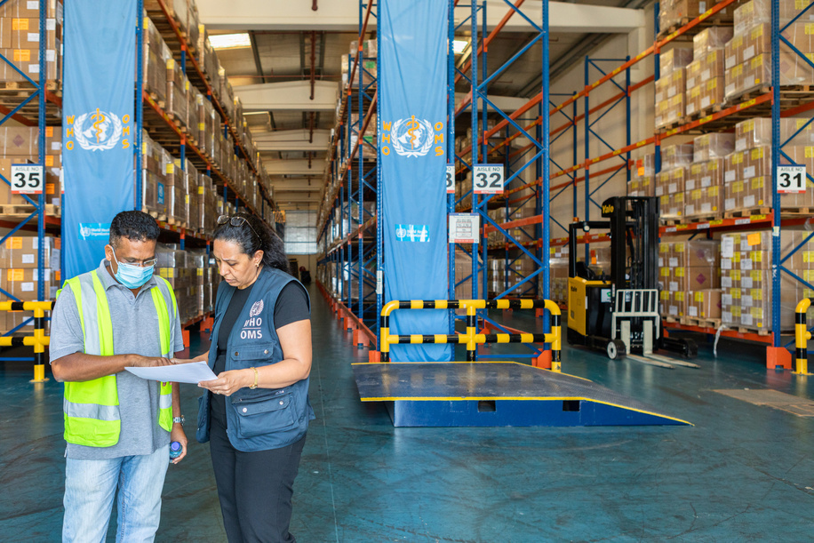 Stanly Godfrey, the head of the DHL team (left), and WHO's Nevien Attalla (right), a pharmacist, inspect medical equipment and medication at a WHO warehouse in Dubai.  The World Health Organization's Health Emergencies Programme maintains a Logistics hub located within the International Humanitarian City in Dubai. The WHO/Dubai operation maintains over 17,000 square meters of temperature-controlled warehousing and manages an inventory of medicines, medical supplies, and equipment valued at USD 40 million. The operation provides support to health emergencies across the globe in response to all types of events ranging from natural disasters to outbreaks of infectious disease. Since the start of the COVID-19 pandemic, the WHO/Dubai operation has expanded to over 4 times its original size and has completed over 324 shipments to 108 destinations across all 6 WHO geographic regions.   With the implementation of a WMS (warehouse management system) including bar-coding and scanning, the operation will gain significant efficiencies in managing inventory and rapidly dispatching supplies. The Operation established a dashboard to increase the visibility of supply chain data to support the tracking and monitoring of medical supplies dispatched from the logistics hub. Most recently, in response to the blast in Beirut, Lebanon the operation responded within 24 hours by delivering over 20 metric tons of trauma and surgical supplies; clearly demonstrating the rapid response capability and advantages of maintaining a pre-positioned supply of critical medical supplies and equipment.