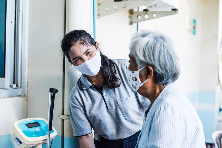 A village health volunteer gives advice to a patient at Koo Bang Luang's health promotion hospital, on 17 July 2020. Village health volunteers help keep people free from COVID-19 and other diseases.