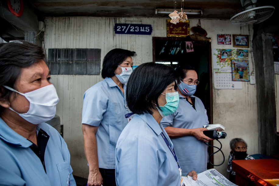 Health volunteers from Bang Phut Sub District make home visits on 23 September 2020.