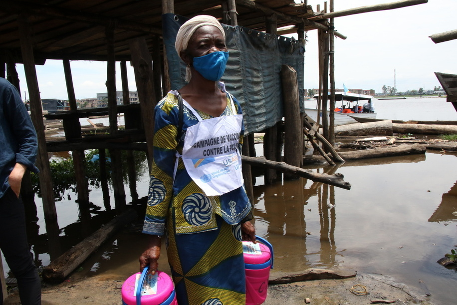 Mosobe Ngoy, 57, has been a vaccinator since 2014. Here she is out on a polio vaccination campaign on the small islands around Kinshasa on the Congo River. The campaign was launched by the Ministry of Health with WHO and partners support, targeting children under 5 years old.