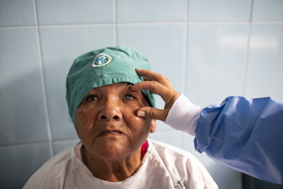 Lima - 20 March, 2018: A doctor checking Andrea Castillo Duran in the pre-operation room of the Maternal and Child Health Center Daniel Alcides Carrion in Villa María del Triunfo neighborhood in Lima. In this Health Center the priority is to have an early diagnosis on eye problems, from the kids to the elderly patients. They focus in cataracts, refractive errors, prematurity retinopathy, diabetic retinopathy, glaucoma as well as external diseases of the eye.  Few years ago they even started to do their own cataract operations due the high number of patients with this pathology that they have and the over saturated health system in Lima.