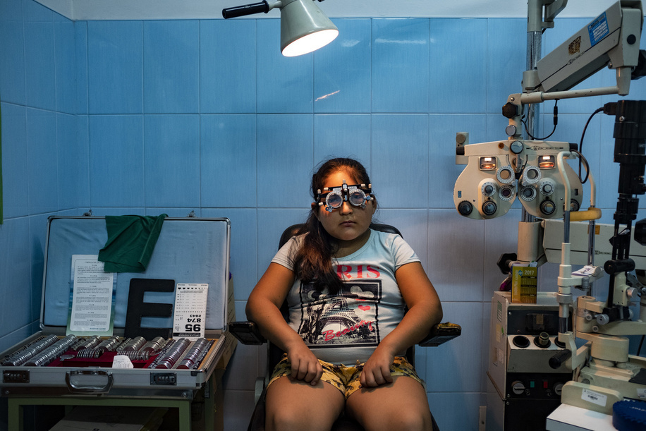 Lima - 20 March, 2018: Heidy Cordova Ramirez, 10 having her vision examination at the Maternal and Child Health Center Daniel Alcides Carrion in Villa María del Triunfo neighborhood in Lima. 