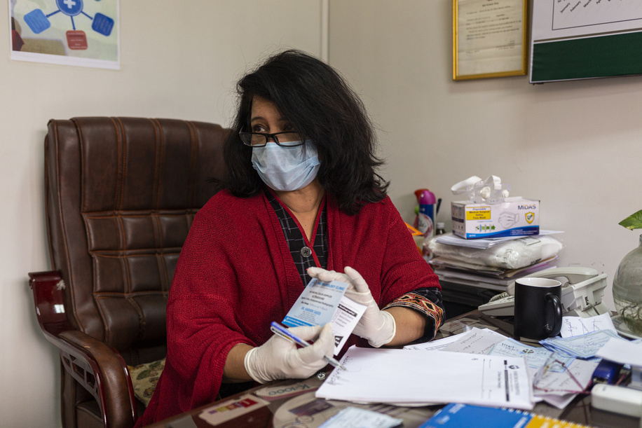 Dr Rukhsana Bashir, a quality assurance officer, photographed in her office on 1 Feb 2021 at the Family Health Hospital in Lahore, Pakistan.  Dr Bashir has been trained by WHO to use its clinical and policy guidelines: Responding to intimate partner violence and sexual violence against women. She further trains health workers how to provide survivor-centered care including how to ask about violence and how to provide first-line support.   Dr Bashir is one of more than 1000 doctors, nurses, hospital administrators and community health workers, including midwives who were trained between 2018-2020 as part of the roll out of the clinical and policy guideline package by Pakistan Ministry of National Health Services Regulation and Coordination and provincial health departments, with technical support from WHO and sister UN agencies, to strengthen the country  health systems response to gender-based violence.  When women come to the clinic, they don't think that they are going to discuss the problem [of violence], but I have to ask them a few bold questions. In the beginning they are afraid and don't want to tell me anything, but you have to identify their problems. Only then can you offer better services and treatment,