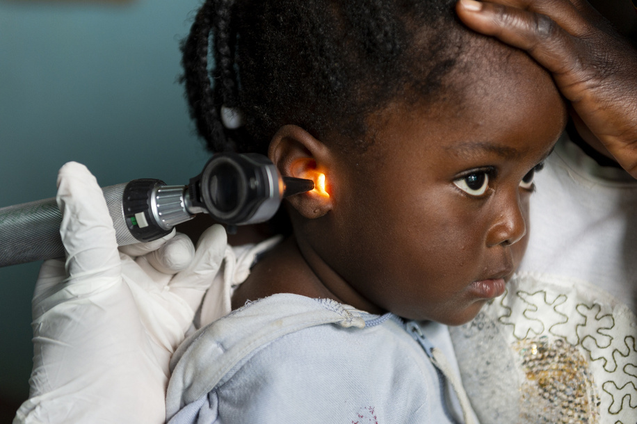 Nurse Carol Sinkende treating Memory Chisenga, 3, for a severe ear infection at the Lukomba Rural Health Centre in Kapiri Mposhii District, Zambia.   Worldwide, 1 in 5 people are living with hearing loss issues. Nearly 80% of people affected with hearing loss live in low- and middle- income countries where ear and hearing care services are lacking, especially at the community and primary levels. This is largely due to insufficient numbers and unequal distribution of health care professionals and distance from health facilities. If unaddressed, hearing loss has far-reaching consequences such as delayed language development, academic underachievement, social isolation, cognitive decline, higher risk of injuries and increased poverty.   In Zambia, with five ear, nose and throat (ENT) specialists and one audiologist serving a population of 17 million, task-sharing is crucial to address the ear and hearing care needs of the population. With the support of WHO training resources, nurses from 92 health facilities across Zambia have undergone training on ear examination and services. This has not only improved access to these services, but has also helped raise awareness at a primary care level. Over the past two years, more than 15 000 people have been reached with efforts to prevent, identify, and address hearing loss.  Nurse Carol Sinkende lives in Kapiri Mposhi and works at Lukomba rural health center. She is at the forefront of community outreach in Zambia. Sinkende works in a clinic in a remote area overseeing different health topics, which now includes ear and hearing care services after being trained with WHO ear and hearing care resources. She also mentors other community health workers to increase outreach and raise awareness about hearing loss.
