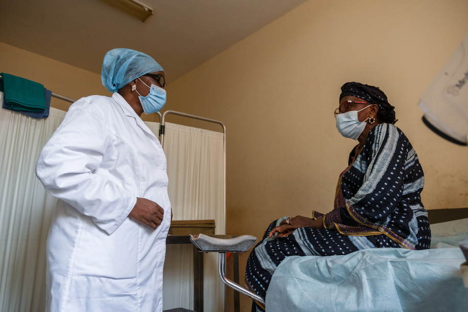 Kadiatou Diallo speaks to a doctor during an annual check up at Donka University Hospital in Conakry, Guinea. Diallo is a survivor of cervical cancer. She was diagnosed in 2010 and went into remission in 2012.   The Francophone Regional Center for Training and Prevention of Gynaecological Cancers (Centre Régional Francophone de Formation et de Prévention des Cancers Gynécologiques) located at Donka University Hospital in Conakry, Guinea, is a regional training facility that offers screenings, training, and treatment of precancerous and cancerous lesions, including surgical treatment and chemotherapy when necessary. The Centre often hosts regional training workshops to provide technical support to African countries in order to improve their capacities for screening and preventive treatment of cervical cancer.
