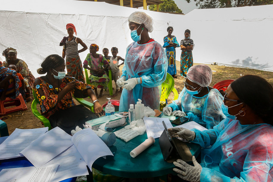 On 26 February 2021 Nurse N'dore Kassie prepares to administer a dose of the rVSV-ZEBOV Ebola vaccine to a woman in the community of Gouéké.    This is the first time the disease has been reported in Guinea since the previous outbreak ended in 2016. The Ministry of Health of the Republic of Guinea announced a new outbreak of Ebola virus disease on 14 February 2021 after a cluster of cases was reported in in the sub-prefecture of Gouéké, N'Zérékoré Region.   WHO is supporting the Government-led response to set up testing, treatment structures, and with medical supplies, vaccines, therapeutics, and diagnostic capacities to quickly contain the outbreak.