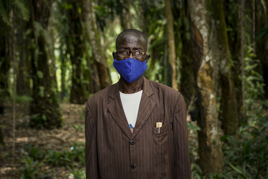 On 1 March 2021, Chief Mankoye Delamon poses for a portrait in the town of Sibata near the Guinea/Liberia border. As part of the Ebola outbreak response, WHO and parters work with local leaders to help engage communities with provide them with information about how to protect themselves and prevent the spread of the virus.  This is the first time the disease has been reported in Guinea since the previous outbreak ended in 2016. The Ministry of Health of the Republic of Guinea announced a new outbreak of Ebola virus disease on 14 February 2021 after a cluster of cases was reported in in the sub-prefecture of Gouéké, N'Zérékoré Region.  WHO is supporting the Government-led response to set up testing, treatment structures, and with medical supplies, vaccines, therapeutics, and diagnostic capacities to quickly contain the outbreak.