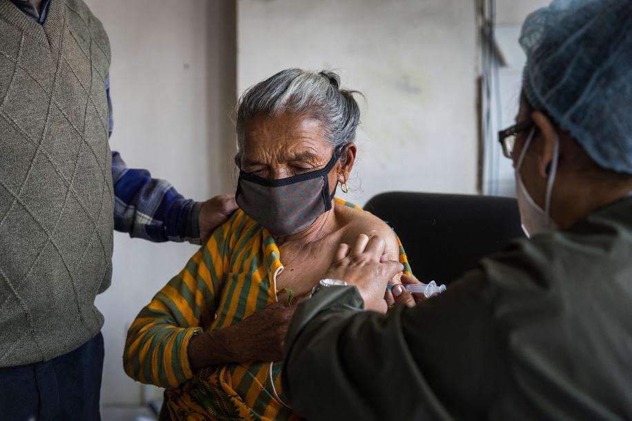On 11 March 2021, Dhana Laxmi Gautam receives COVID-19 vaccine at Paropakar Maternity and Women's Hospital in Kathmandu, Nepal.