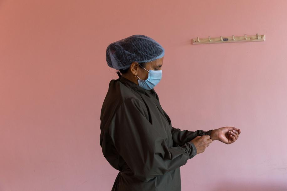 On 12 March 2021, Senior Vaccinator Sarita Bajagain prepares to administer COVID-19 vaccines at Paropakar Maternity and Women's Hospital in Kathmandu, Nepal.