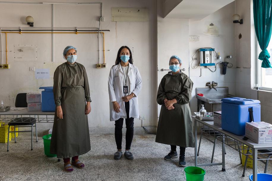 On 12 March 2021 health workers Sarita Bajagain (left), Dr Karishma Malla Vaidya (centre) and Resa Prakash Gurung (right) at the COVID-19 vaccination centre at Paropakar Maternity and Women's Hospital in Kathmandu, Nepal.