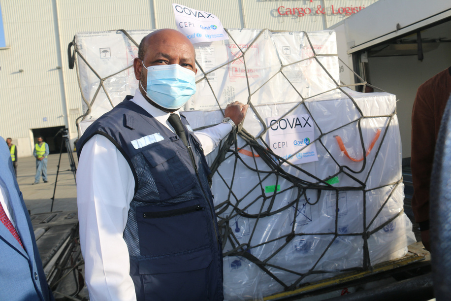 """On 7 March 2021, Dr Boureima Hama Sambo, Ethiopia's WHO representative, helps to receive Ehtiopia's first consignment of COVID-19 vaccine. 2.2 million doses of the AstraZeneca COVID-19 vaccine arrive at Bole International Airport in Addis Ababa, Ethiopia. The delivery was facilitated by the COVAX mechanism and marks the start of the country's COVID-19 vaccination campaign, which launched on March 13.   """"The arrival of the vaccines in Addis Ababa is a major milestone, a turn of the tides for the better, in the response to the COVID-19 pandemic, thanks to the coordinated global action for equitable vaccine distribution,"""" Dr Boureima Hama Sambo, WHO Representative in Ethiopia, said. """"WHO will continue to work with the Government of Ethiopia and global partners to ensure that Ethiopia receives, deploys and administers adequate quantities of COVID-19 vaccines to the Ethiopian people, because as WHO has repeatedly said, no one is safe until everyone is safe.""""  COVAX, the vaccines pillar of the Access to COVID-19 Tools (ACT) Accelerator, is co-led by the Coalition for Epidemic Preparedness Innovations (CEPI), Gavi, (the Vaccine Alliance) and the World Health Organization (WHO) – working in partnership with developed and developing country vaccine manufacturers, UNICEF, the World Bank, and others. It is the only global initiative that is working with governments and manufacturers to ensure COVID-19 vaccines are available worldwide to both higher-income and lower-income countries."""