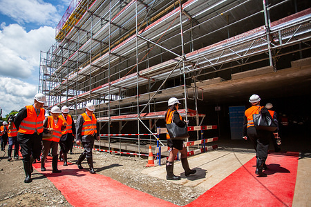 Members of the 145th session of the WHO Executive Board and WHO staff arrive to the construction site of the new WHO building for the first stone ceremony.