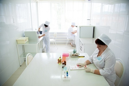 Illustration about blood safety in Russia  A laboratorian is analysing samples, Tambov, Russia.