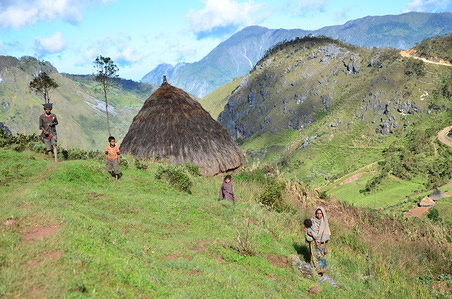 Feature on life in Timor-Leste  A family stands next to their hut in the mountains of Timor-Leste.