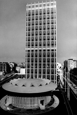 The International Agency for Research on Cancer (IARC) is part of the World Health Organization. IARC coordinates and conducts both epidemiological and laboratory research into the causes of human cancer.  View of the headquarters of IARC in Lyon, France. Donated by the French authorities, the building comprises a 14-floor tower with laboratories, conference rooms and offices and a separate circular 240-seat auditorium.