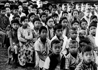 In most countries, people either don't know the facts about leprosy, or they imagine that with today's technological advances it is no longer a problem. WHO continues to give careful attention to the problem of leprosy, to determine more exactly how many people are affected, and to find effective means of taking action.  Burmese children listen to a talk by a leprosy inspector.  c.1968