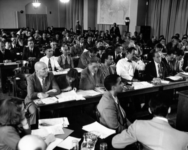 The International Health Conference was held in New York from 19 June to 22 July 1946. In four and a half weeks the Conference succeeded in producing: the Constitution of the World Health Organization ; a protocol for the termination of the Rome Agreement of 9 December 1907 and the performance by the Organization, or the Interim Commission, of the duties and functions of the Office International d'Hygiène Publique (OIHP) ; and an arrangement for the setting-up of an Interim Commission to make preparations for the First World Health Assembly, to carry on without interruption the surviving activities of the League of Nations Health Organisation and those of the OIHP and United Nations Relief and Rehabilitation Administration (UNRRA), and to perform other urgent duties pending the final establishment of the Organization.  The International Health Conference, held in New York, June - July 1946. General view of a Plenary Session. - Title of WHO staff and officials reflects their respective position at the time the photo was taken.