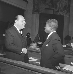 Seventh World Health Assembly (WHA7), Geneva, 4 - 21 May 1954  Dr Marcolino G. Candau (left), Director-General of the World Health Organization talks with Dr Joseph N. Togba, after his election as President of the Seventh World Health Assembly. - Title of WHO staff and officials reflects their respective position at the time the photo was taken.
