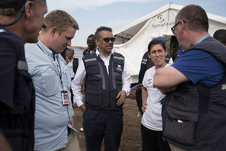 World Health Organization (WHO) Director-General Dr Tedros Adhanom Ghebreyesus (centre) speaks to staff from Samaritans Purse in Komanda on 01 January 2019. The NGO was in the process of setting up an Ebola Treatment Unit  in Komanda, one of the current epicentres of the ongoing Ebola outbreak.  Dr Tedros traveled over the New Year to Ebola-affected areas in the DRC to review the response at this critical phase. On the three-day mission (31 December 2018 - 2 January 2019) to Beni, Butembo and Komanda, Dr Tedros took stock of the outbreak, spent time with affected communities, and personally thanked responders for their dedication. WHO has 380 response staff in North Kivu and Ituri working together with hundreds more from the Ministry of Health and partners.